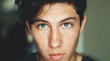 Young man looking directly into the camera