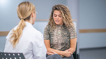 A woman in a CBT session