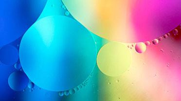 Coloured oil bubbles in water